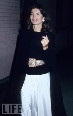 Jackie Onassis dresses up simple black and white at an event at New York's Lincoln Center, 1983.