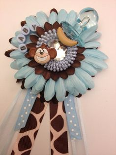 Blue and brown baby Shower Corsage. Gender neutral baby shower. Perfect for jungle or monkey themed shower. via Etsy