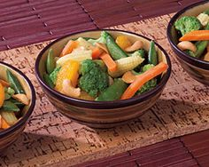 Orange Cashew Vegetables - 1.Toss cooked vegetables with mandarin oranges, orange juice and cashews in a bowl until well combined.