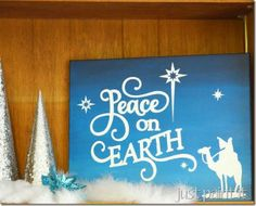 paint a Christmas Canvas using reverse stencils and wet-blending for ombre sky.