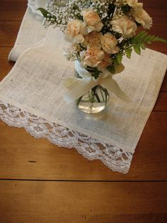 Burlap & Vintage Lace Table Runner, Vanilla Burlap -- super easy idea.  I'd make a better match on the colors, though ...