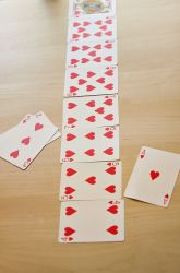 Card Pick Up: each team of 2 uses one suit of cards layed out in ascending value; each player can take 1 or 2 cards in ascending order; last one to take a card is the winner.)