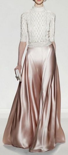 Jenny Packham. Wearing the skirt you could attend a swanky gala. Remove the skirt and slip on a pair of jeans...it works.