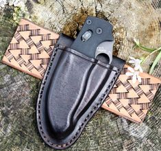 This is a custom (hand made) friction fit sheath for a Spyderco Manix 2 folding knife. It is shown right handed; just let us know if you require