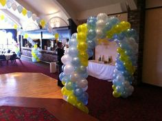 Azure blue, white and yellow twisted arch