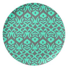 Intricate Bright Teal Heart Pattern Against Gray Plate