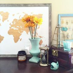 Not quite a #shelfie but I couldn't resist the urge to gram my dresser-in-progress with a few new gold pieces! Wouldn't be complete without my world map of course. Going for a colorful happy scheme of aqua  gold! Tap to see where it's all from!
