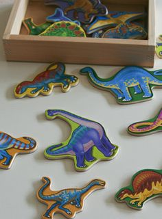 Melissa & Doug wooden dinosaur magnets used in the birthday party invitations