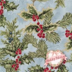 "Holiday Flourish 6 AEBM-13639-254 Frost By Elizabeth Brownd For Robert Kaufman Fabrics: Holiday Flourish 6 is a collection by Elizabeth Brownd for Robert Kaufman Fabrics.  100% cotton.  43/44"" wide.  This fabric features holly leaves and berries and pine branches with gold metallic accents on a blue background."