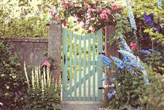 Seafoam green gate garden with pink roses hovering above