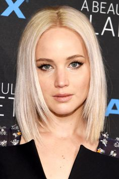 Jennifer Lawrence went sleek with her platinum hairdo. After straightening your hair with an iron be sure to apply anti-frizz serum and set with hairspray to fight flyaways and humidity.