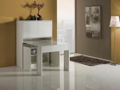 Astra cabinet incorporating extending dining table in white lacquer