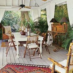 """Out of Africa"" style porch: a covered patio furnished in the British Colonial style Outdoor Rooms, Outdoor Dining, Outdoor Furniture Sets, Outdoor Decor, Outdoor Kitchens, Outdoor Patios, Rattan Furniture, Outdoor Cabana, Outdoor Curtains"