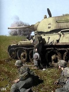 Combat engineers from the 3 SS tank division. Soldier holding an anti-tank mine.