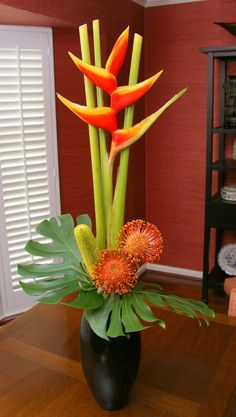 Love orange and yellow heliconias, pincushion proteas and banksia for Aid Sudan benefit.