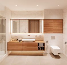 Large tiles help to make this room spacious. Cabinets that stop above the floor allow storage underneath. The simplicity of this bathroom is what makes it special