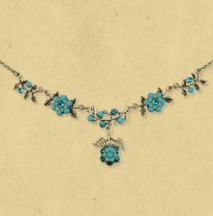 Handmade Michal Negrin necklace - hand-painted brass flowers and swarovski crystals  #jewellery #jewelry