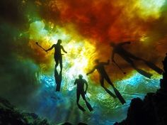Another World ~ Photo by Anai Colyer — Devil's ear at Ginnie Springs ~ my friends silhouettes among the changing colors where the tannin rich water of the Santa Fe River (Florida) mix with the crystal clear water from the spring.
