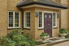 Casement Windows and Wooden Entrance Door by Marvin