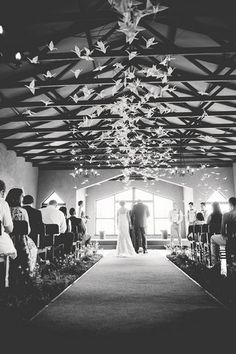 "Origami Bird Hanging Decor: Their beautiful wedding ceremony chapel venue was decorated with endless floating origami birds suspended from up above from ""rosyntjiebos"" branches with grass lanes running down the aisle.    See more of this Rock Roses & Romance, South African Wedding here! ♥  ♥  ♥ Follow us on Facebook: www.facebook.com/confettidaydreams ♥  ♥  ♥ Rock Roses & Romance #Gauteng #Wedding #SouthAfrica #succulents #rustic Shot by #LouiseVorster"