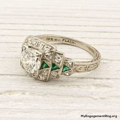 antique engagement ring - love the emerald and the filigree and the delicacy but still a little square shaped for me
