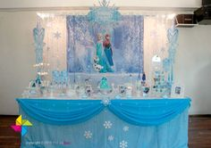 A Frozen themed party for a 6 year old girl! Design and setup of backdrop, candy buffet. etc by ParteeBoo - The Party Designers!
