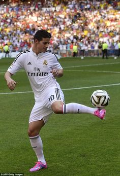James Rodriguez Real Madrid Taking it down: Rodriguez wore some pink and blue boots during his unveiling..