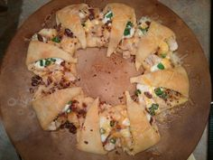 Chicken Bacon Ranch Cresent Ring *one can Cresent rolls *12-16 oz chicken cooked and chopped *cooked bacon crumbles *shredded cheese *ranch dressing *chopped green onions {Spread crescents around your round pan/stone, opened, with small end facing outer rim; cover with above ingredients to your liking; cook on 375 for 8-10 minutes until dough is flaky. Yummy!