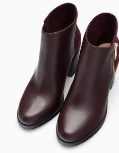 http://www.stradivarius.com/pt/pt/sapatos/todos/botins-salto-fecho-ecler-c1399018p6172026.html?categoryNav=1399018