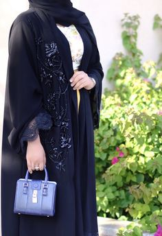 Beaded embroidered abaya is wonderful accent for your stunning look and groomed your modern style. Street Hijab Fashion, Abaya Fashion, Muslim Fashion, Modest Fashion, Fashion Dresses, New Abaya Style, Modern Abaya, Iranian Women Fashion, Modele Hijab