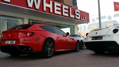 A Ferrari FF with 666 numberplate and another Ferrari GTO...the Showroom os full and they wait their turn to get inside... www.dealsonwheels.ae