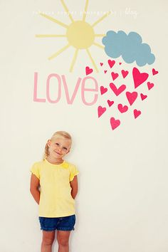 Painted Love, Hearts & Cloud Photo Booth Backdrop | Add paper rosettes, pom poms, flowers, streamers, banners, bunting, ribbon, chairs, side tables, frames, signs, masks and adorable kids.  Ideas for perfect diy birthday party pictures, capturing great memories, family portraits & fun party activities.