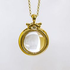 Bubble Pendants A transparent stone, highly polished, held in a delicate mechanism with a top hinge. The bubbles come in two sizes, each a clear, perfect circle.