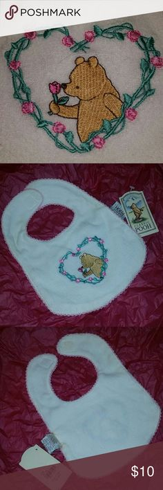 WINNIE THE POOH BABY BIB Heart embroidered roses with Winnie the Pooh patch, just adorable! White terry-cloth baby bib piped with pink edging, velcro neck closure super soft! A classic to become a family heirloom! The perfect baby shower gift! New with tags never used Winnie The Pooh  Accessories Bibs