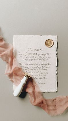A note from a bridesmaid to her bride. Cotton rag paper with calligraphy letter, finished with a gold wax seal and a silky ribbon