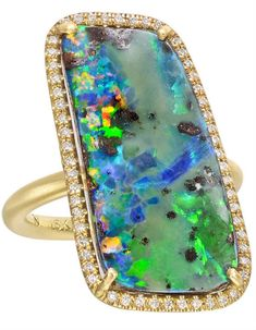 Boulder Opal and Pavé Diamond Ring by Irene Neuwirth Boulder opal cocktail ring, the opal accented by a pavé diamond surround composed of 54 round full-cut diamonds weighing approximately 0.50 total carats, mounted in matte-finished 18k yellow gold