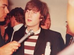JOHN LENNON BEING INTERVIEWED....