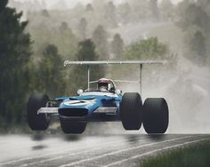 "Jackie Stewart, ""The Flying Scotsman"", taking his Matra Ford for a short flight at the 1969 German Grand Prix on the Nurburgring. Jackie Stewart, Auto F1, Up Auto, Motogp, Grand Prix, Course Moto, Alpine Renault, Aryton Senna, Classic Race Cars"