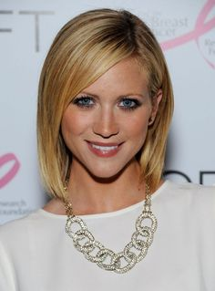 2014 Brittany Snow's Short Hairstyles: Easy Cute Asymmetrical Bob-The neck-length short hairstyle created by Brittany Snow makes a classic statement with blunt ends and bangs. She gives her bangs a soft sweep and creates a deep side part on the classic blunt bob. For neater effect, you can apply some light volumizing serum.