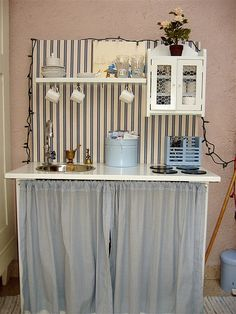 Love this. The stripes, the more chill color scheme, the little upper cabinet with chicken wire.