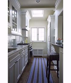 Elegant, space-saving galley kitchen with pass-through window to an adjoining dining room. | Michael Luppino | thisoldhouse.com
