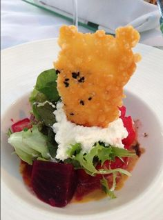 Beet and tomato salad with goat cheese while enjoying the sunset in Hawaii