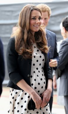 Catherine Middleton wore a polka dot dress from Topshop and Ralph Lauren jacket, April 2013