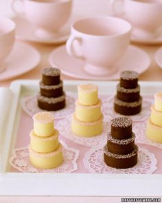 "Delight guests at a wedding or shower with their own tiered ""cake."" For these fudge treats, which can be made with white or dark chocolate, cookie cutters form bite-size layers resembling those on a wedding cake. Pink sanding sugar serves as icing, and paper doilies enhance the dainty display."
