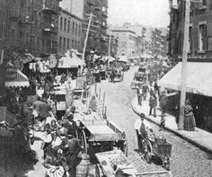 America's Gilded Age in NYC - 1880's. Pushcarts and tenement shoppers, congregated on Hester Street located on, The Lower East Side of New York City. ~ {cwlyons}