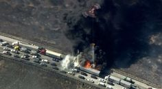 Multiple vehicles were engulfed in flames, aerial video showed. (Credit: KTLA)
