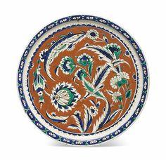 A rare red-ground Iznik pottery dish, Ottoman Turkey, circa 1585-90