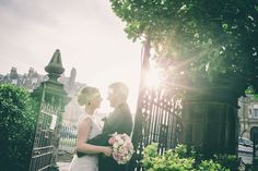 Backlit Bride & Groom, with flared sunlight. Wedding Portrait. The Esplanade, Scarborough, North Yorkshire.