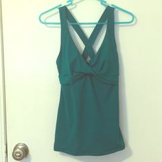 Victoria's Secret Crossback Tank Turquoise tank top from Victoria's Secret with built in bra support. Never worn! Please feel free to ask questions. Thank you! Victoria's Secret Tops Tank Tops