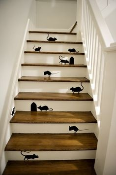 Thinking about doing a staircase remodel for your home? Here is a clever staircase idea. Check out this black mice and mouse holes painting on wooden stairs. Painted Staircases, Painted Stairs, Wooden Stairs, Staircase Painting, Wooden House, Stairs And Staircase, Stair Risers, Staircase Design, Basement Stairs